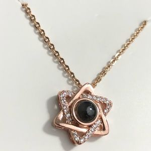 Rose gold Star of David projection pendant